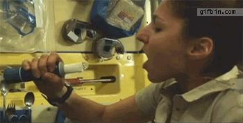 1315053306_woman_drinking_water_in_space